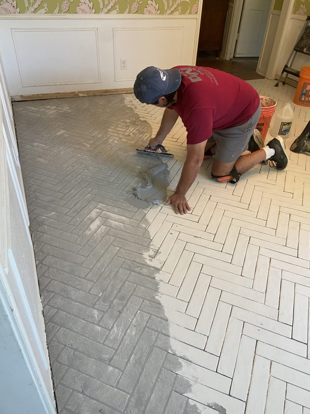 herringbone tile floor, dining room, wallpaper