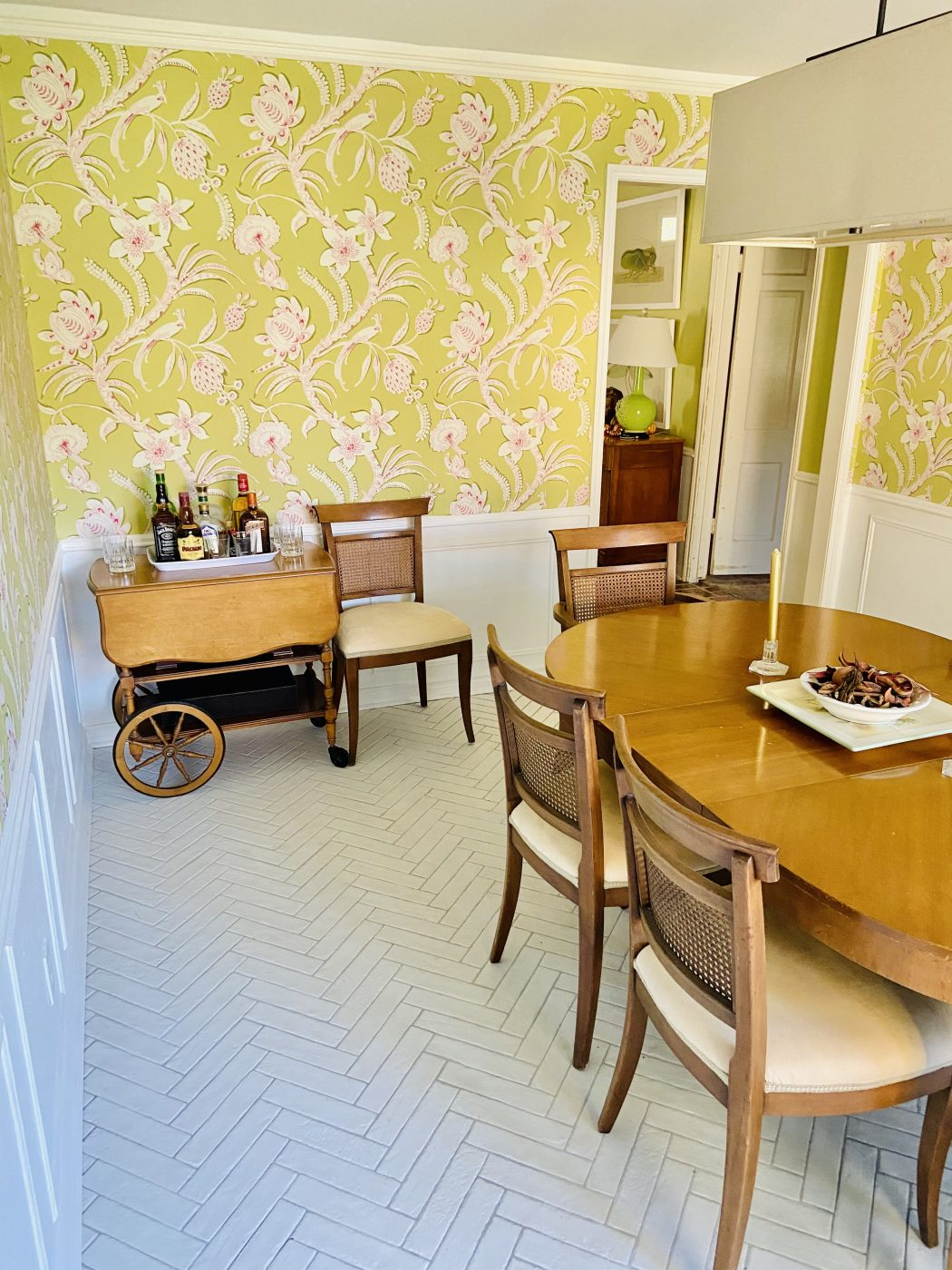 dining room, wallpaper, antique table, herringbone tile floor